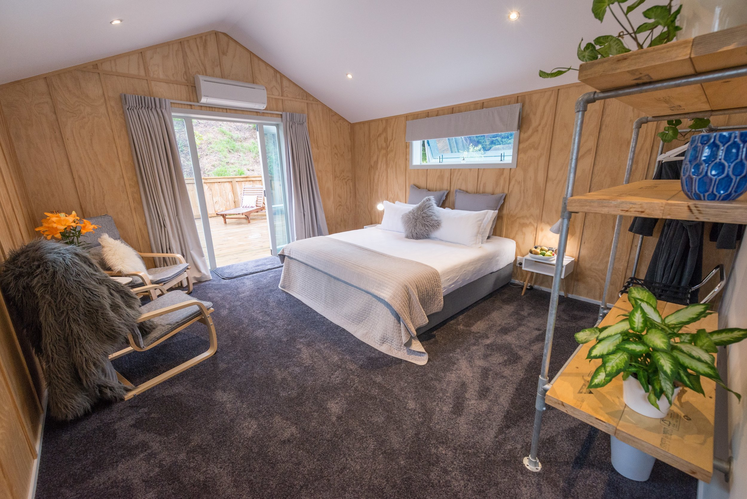 - The lodge has six large rooms each with ensuite. Up-cycled and eclectic, modern and bespoke furnishings. A resort-styled retreat with salt-water pool, sauna, house-bar and BBQ. Walking distance to bars and restaurants.