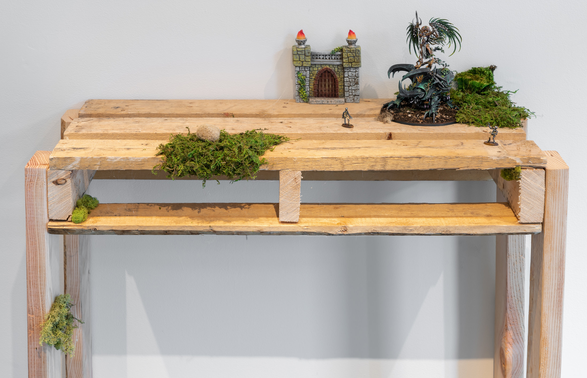 Alarielle The Everqueen , 2018  Hand-painted miniatures (plastic and metal), wood pallet table and various found objects
