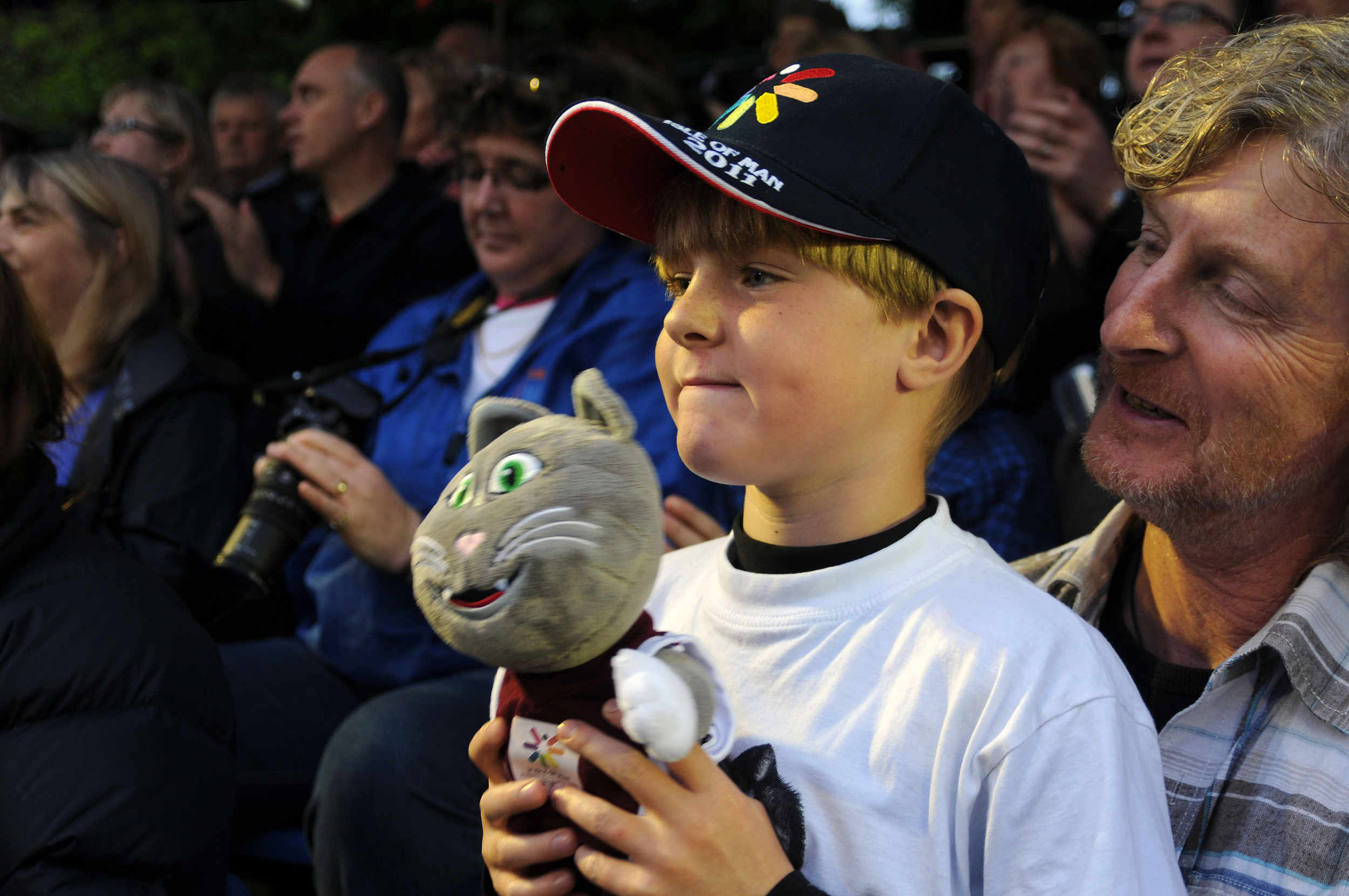 A young fan watches the opening ceremony of the 2011 Commonwealth Youth Games, hosted by the Isle of Man