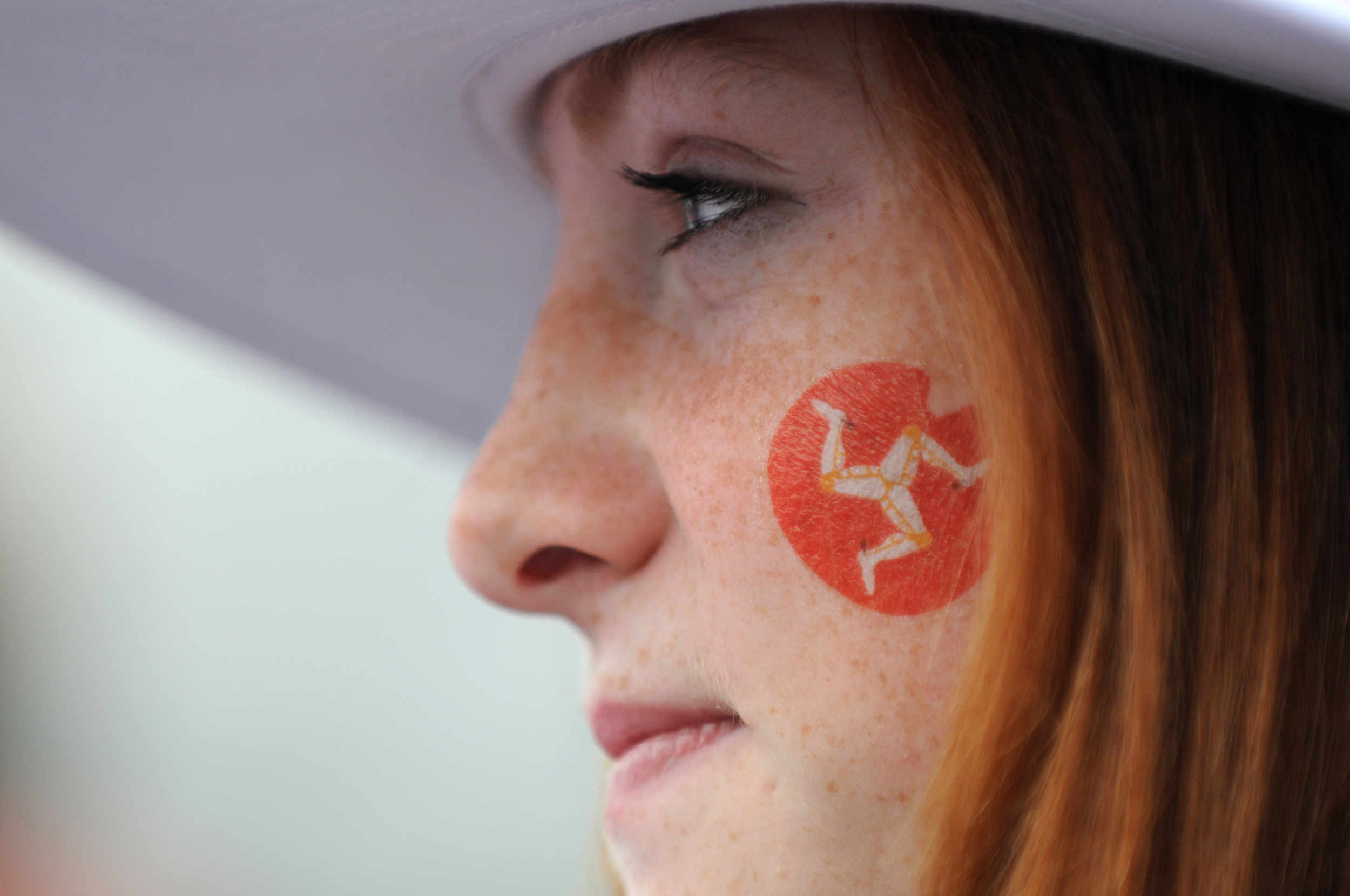 A local competitor from Team Isle of Man wears her nation's flag at the opening ceremony of the 2011 Commonwealth Youth Games