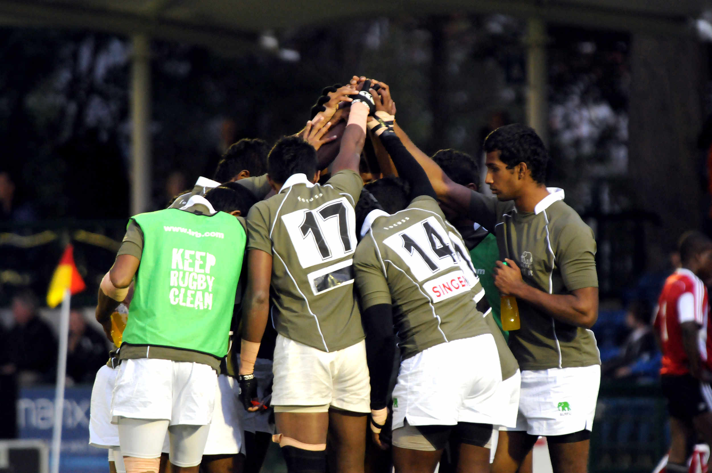 The Sri Lankan Rugby Sevens team prepare to play Trinidad and Tobago in the Grand Final Bowl Match at the 2011 Commonwealth Youth Games