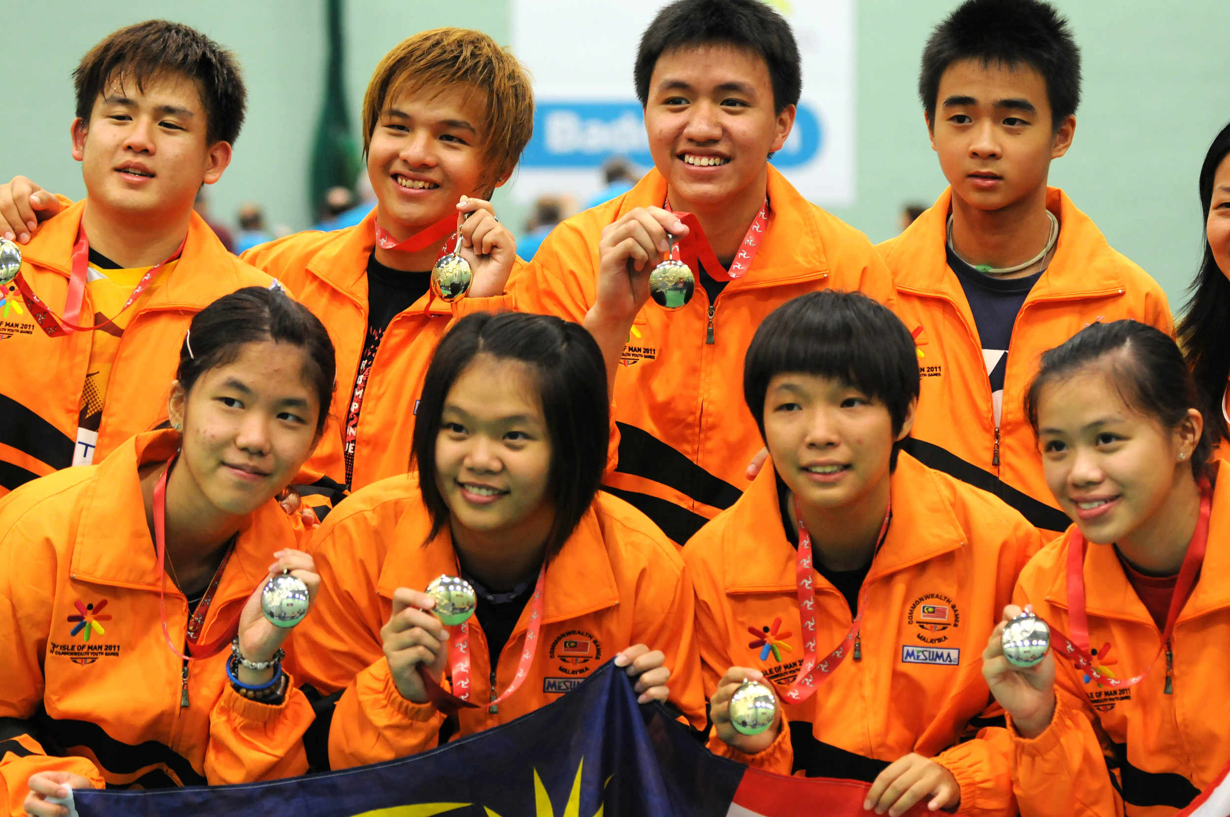 Members of the Malaysian Badminton Team celebrate a haul of medals at the 2011 Commonwealth Youth Games