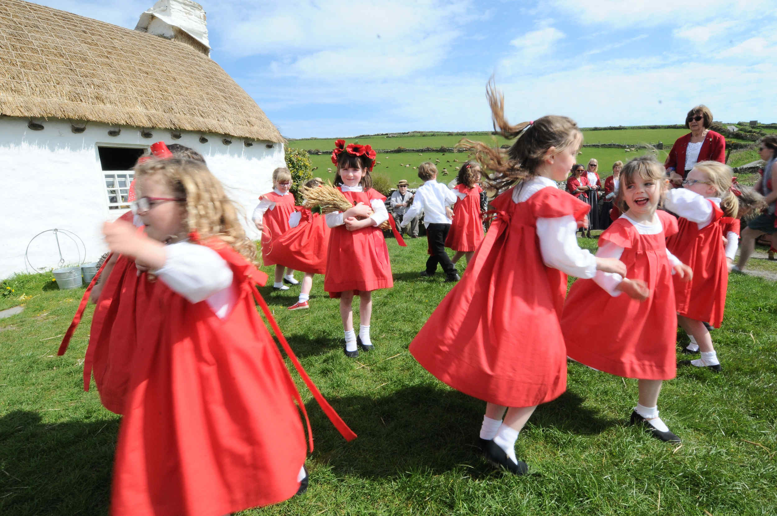 Dance group Perree Bane perform outside Harry Kelly's Cottage in Cregneash as part of Laa Boaldyn, or Manx May Day