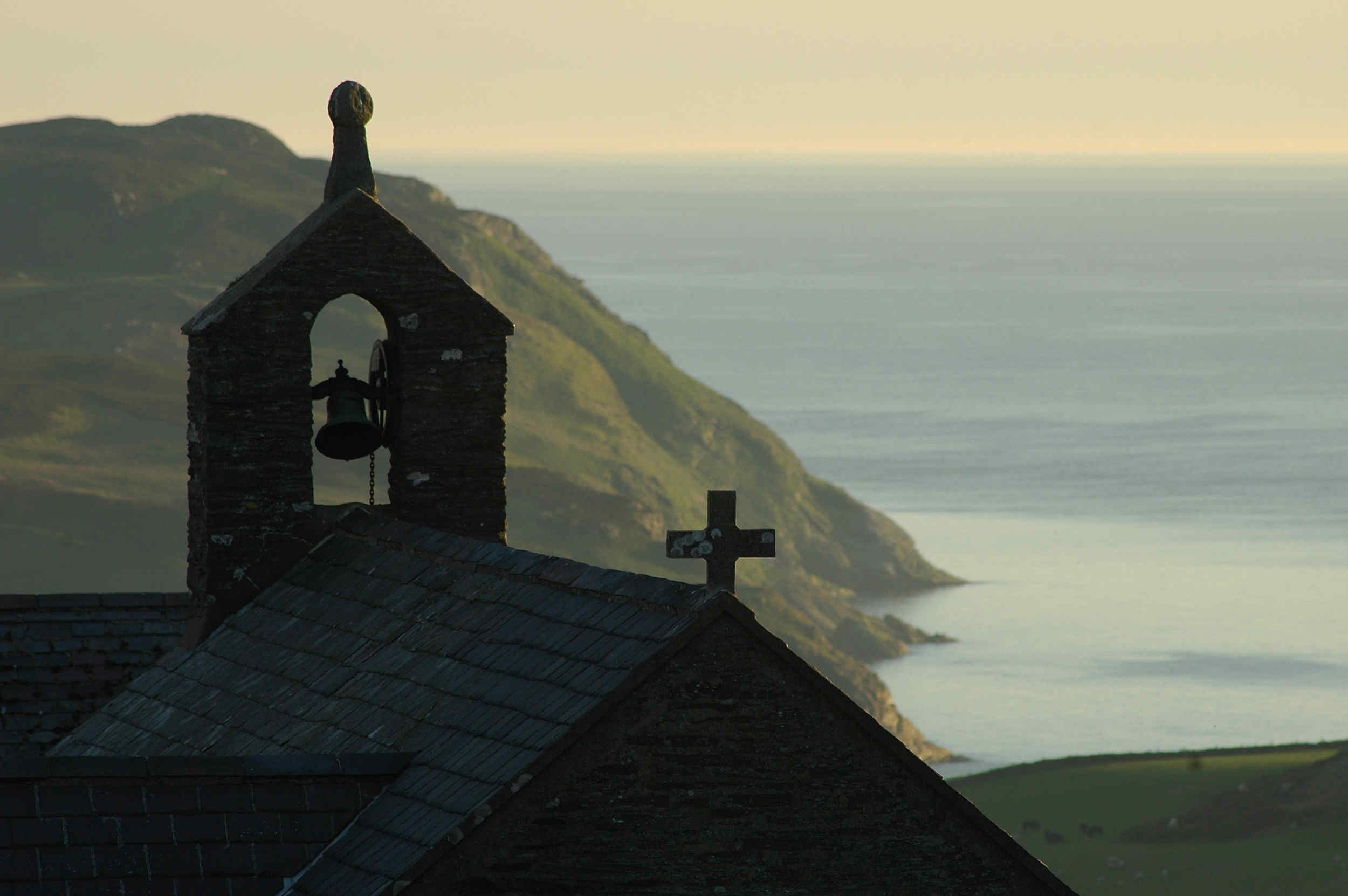 A tranquil sunset at St Peter�s Church in Cregneash, looking south towards the Calf of Man.
