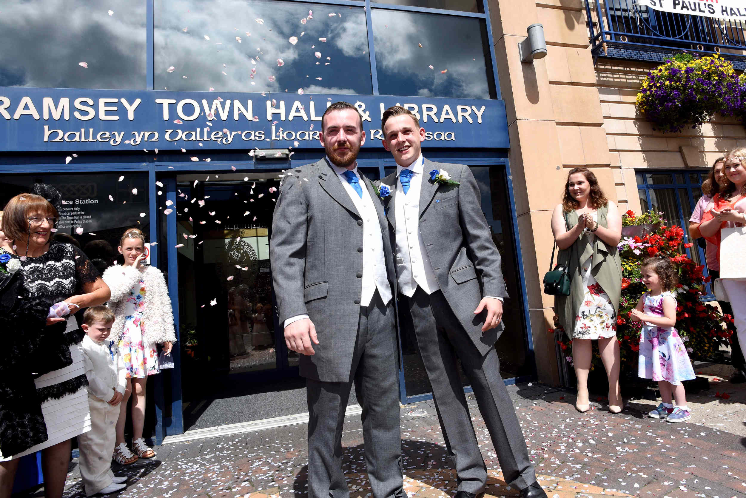 Luke Carine and Zachary Tomlinson are married at Ramsey Town Hall in the Isle of Man's first same-sex marriage ceremony on Saturday, July 30 2016