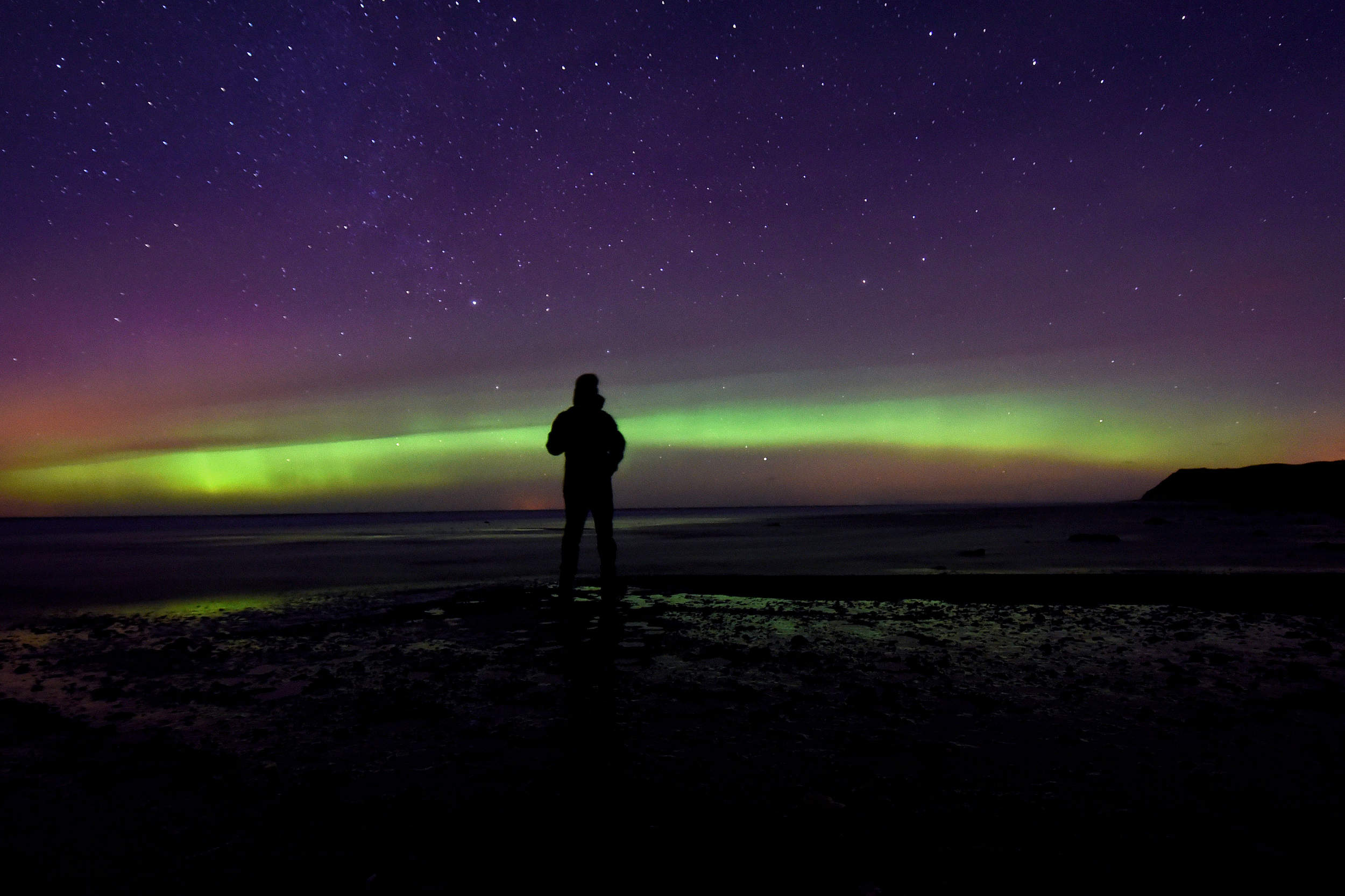 The aurora borealis, or northern lights, seen from Kirk Michael beach on New Year's Day