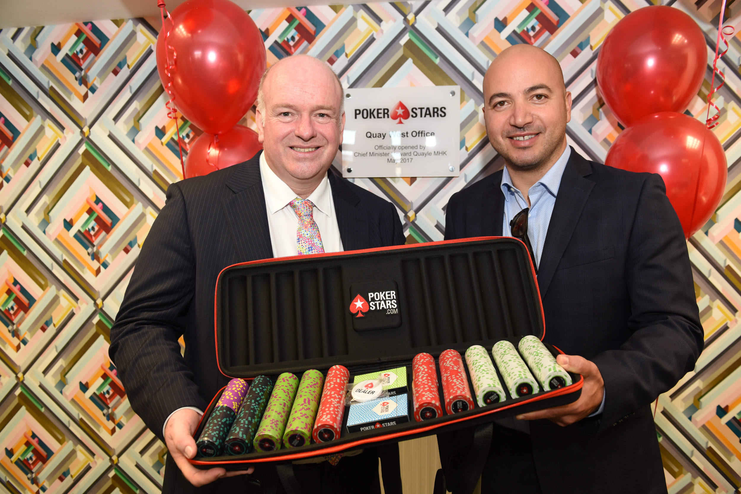 Chief Minister Howard Quayle MHK and Rafi Ashkenazi, CEO of Rational Group/PokerStars, mark the opening of PokerStars' new office in Quay West, Douglas