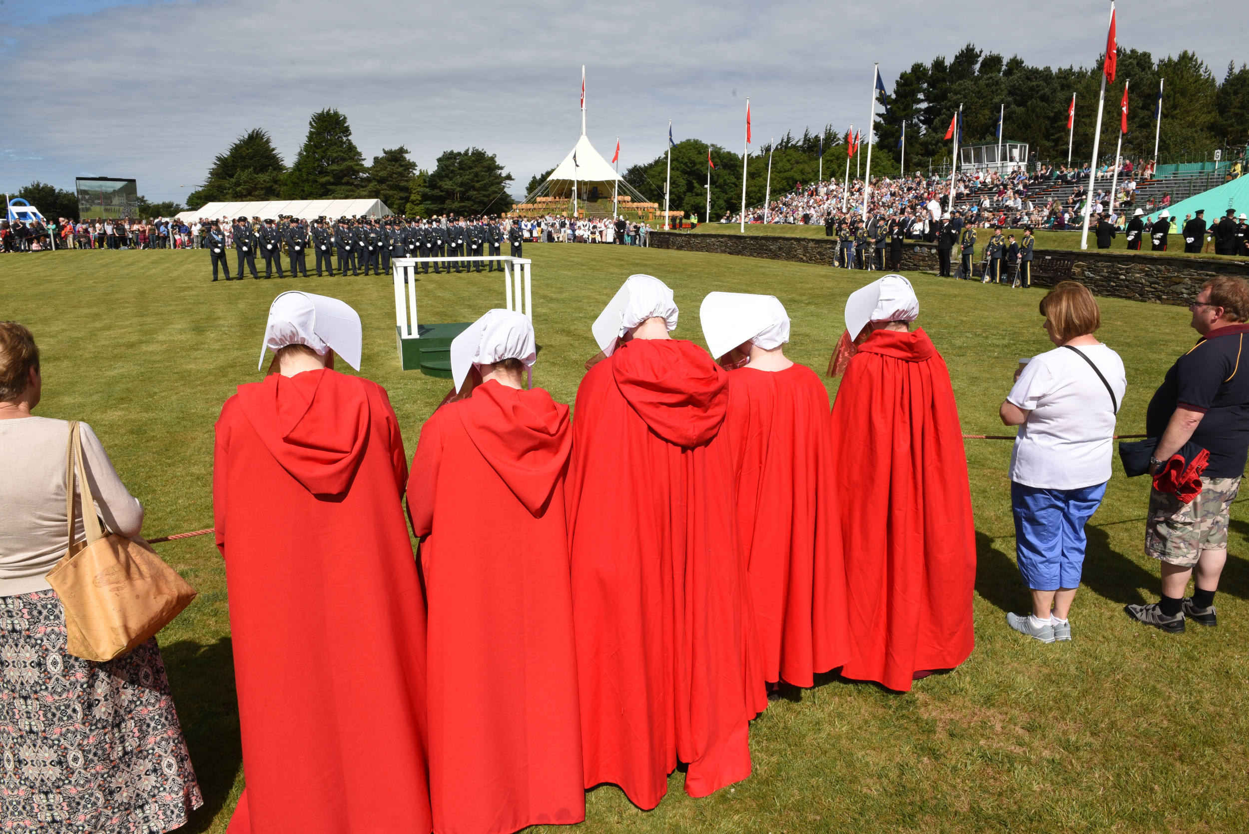 An anonymous pro-choice group, dressed as characters from the Margaret Atwood novel 'The Handmaid's Tale', hold a silent protest during Tynwald Day