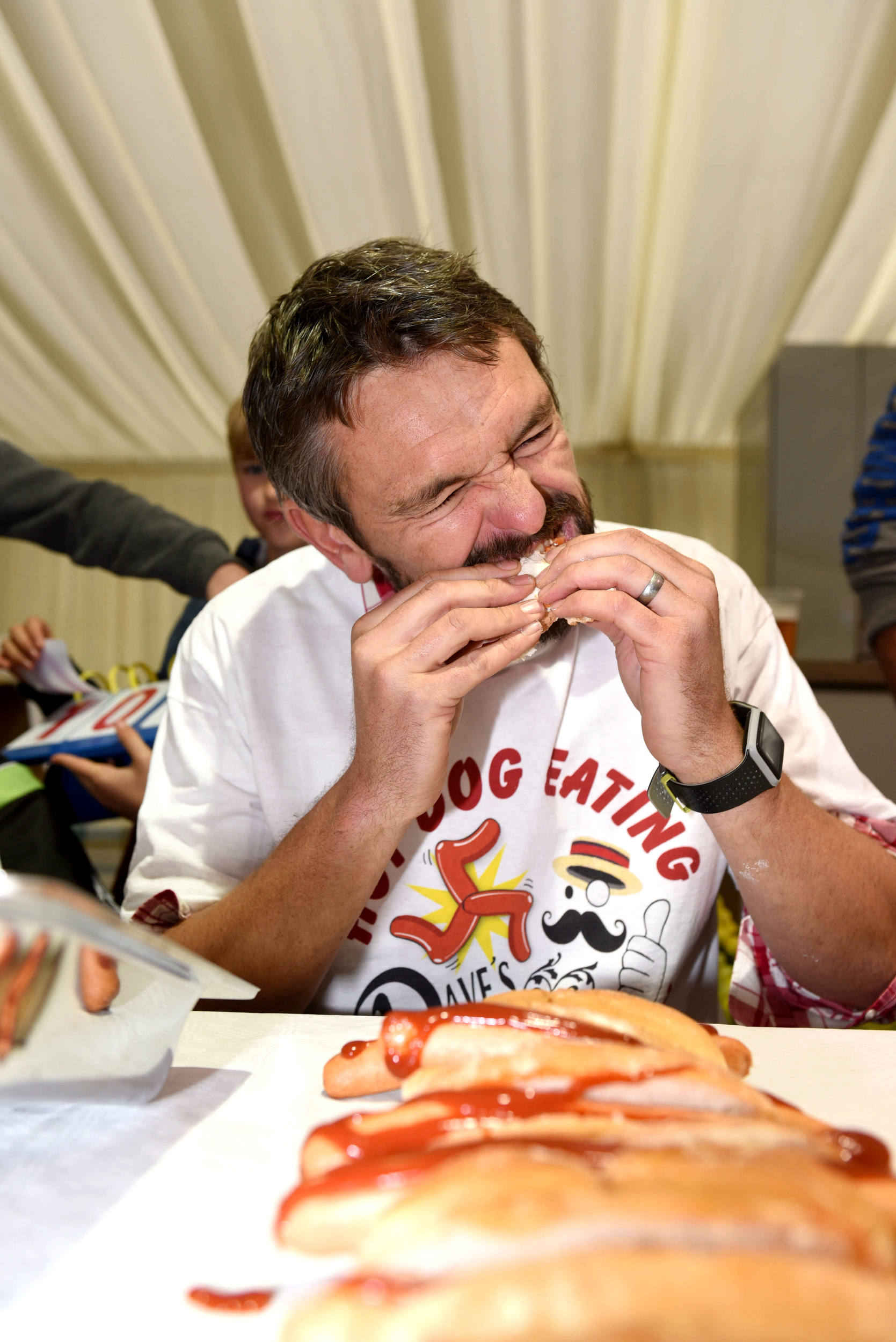 Glen Blacker takes part in the inaugural Hot Dog Eating Contest at the Isle of Man Food and Drink Festival