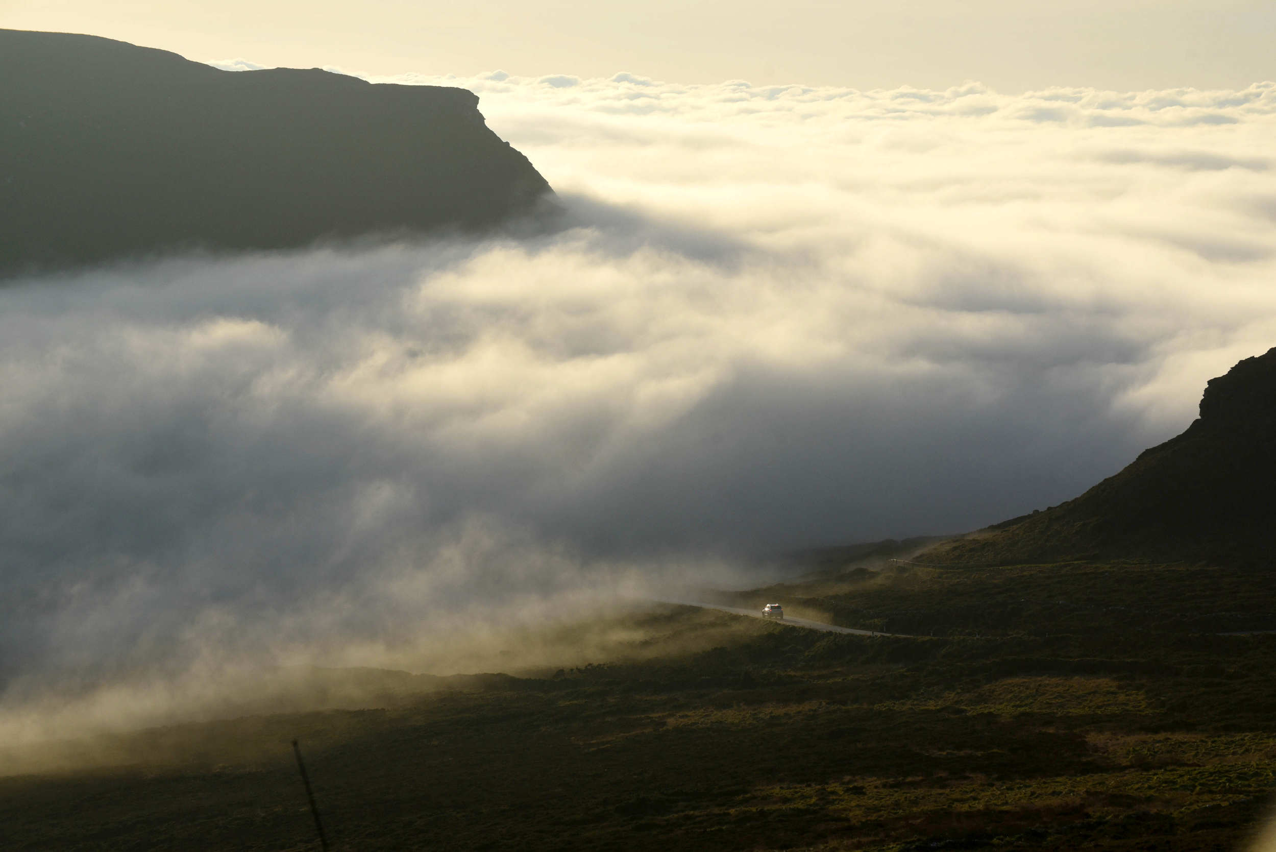 A fog bank obscures the road as it rolls through the Sloc valley