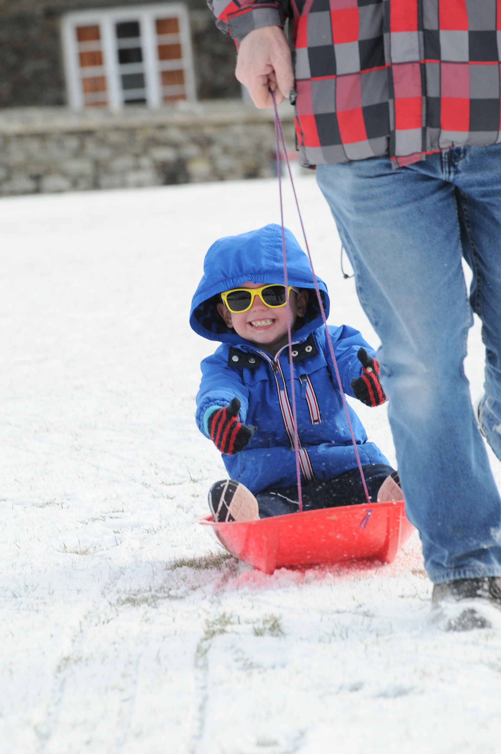 Winter scenes in the West of the island after overnight snowfall - pictured aboard the sledge is Billy Leece (5) being towed by grandad ChrisWinter scenes in St John's after overnight snowfall in the West of the island