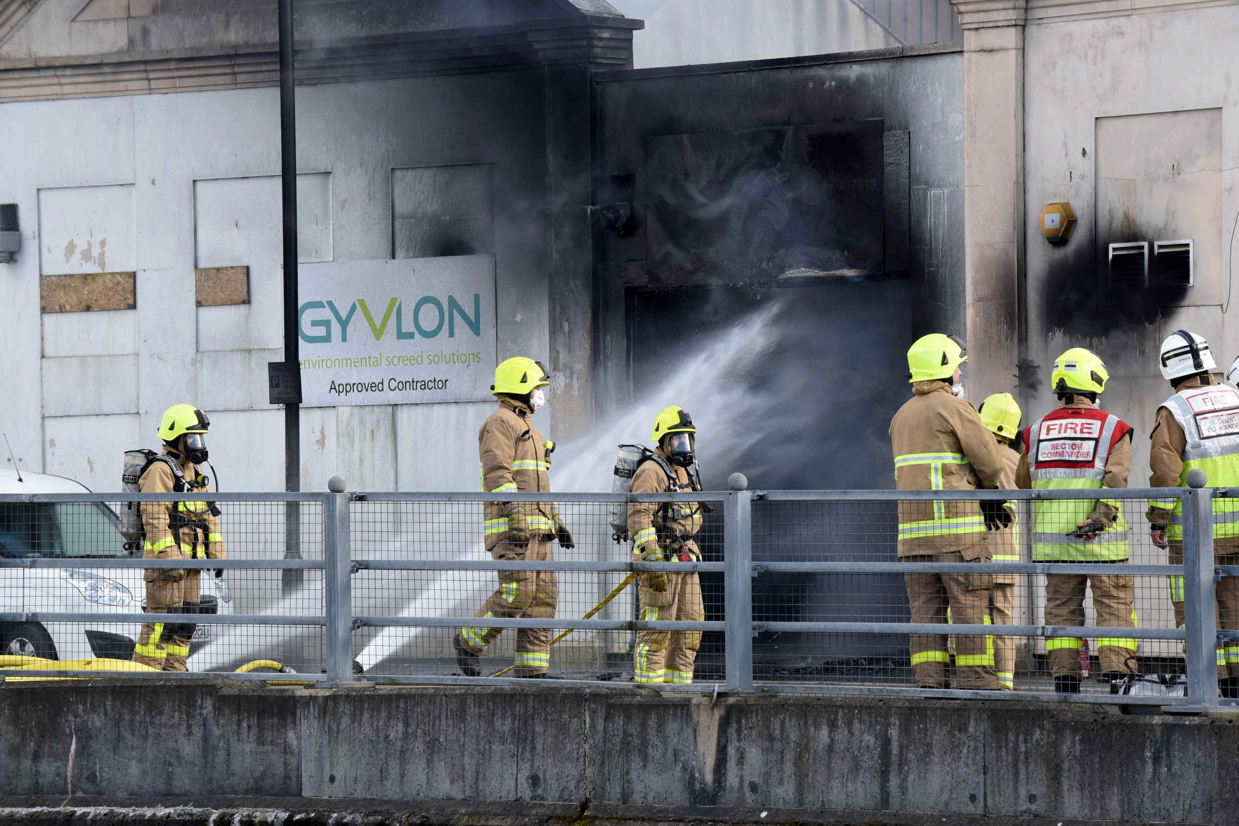 Fire crews work to contain a warehouse blaze on South Quay in Douglas