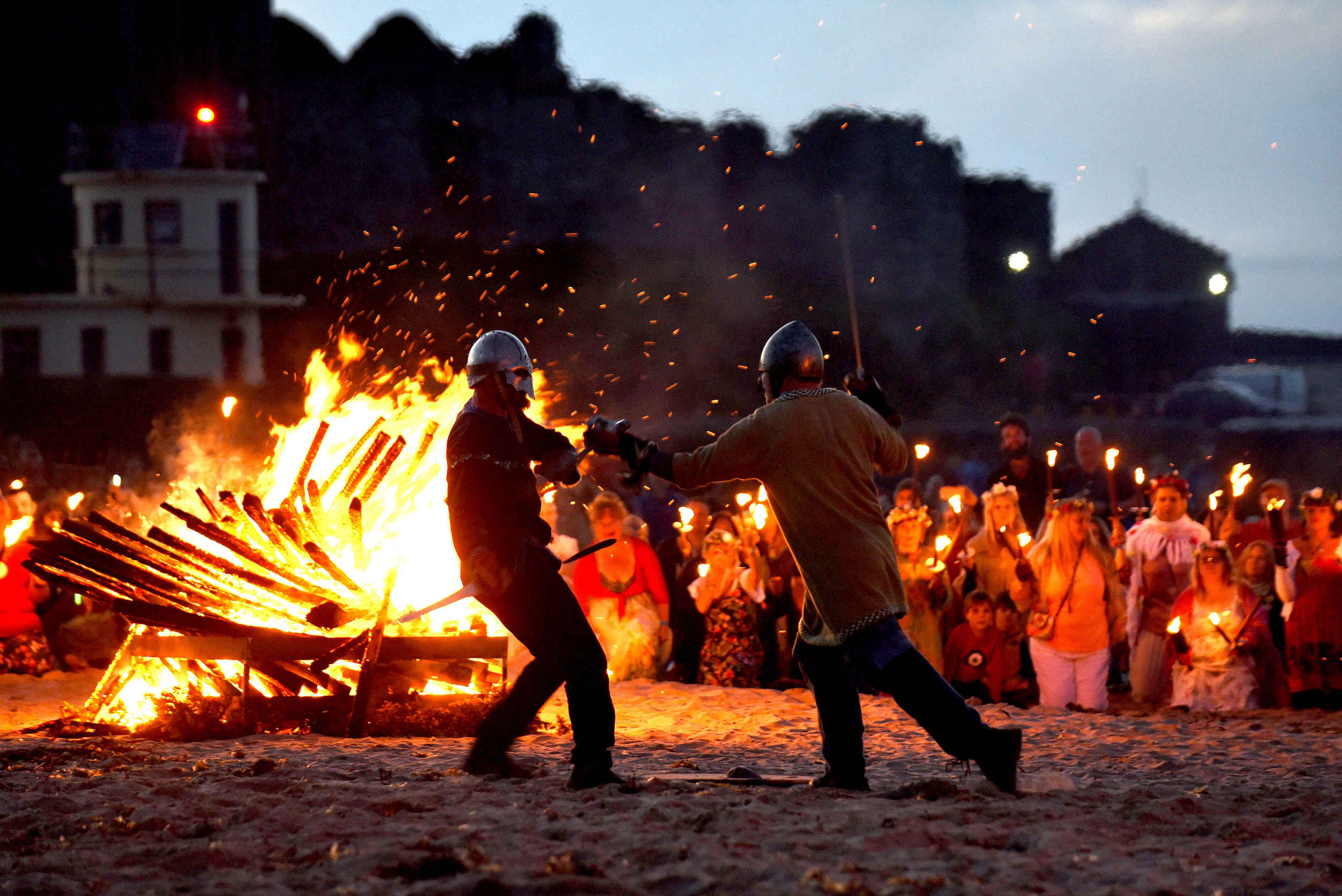 Nominated champions representing Winter and Summer fight for supremacy during the Oie Voaldyn fire festival in Peel -