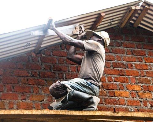 GENOPBYGGE SKOLER DR CONGO STREET CHILD.jpeg