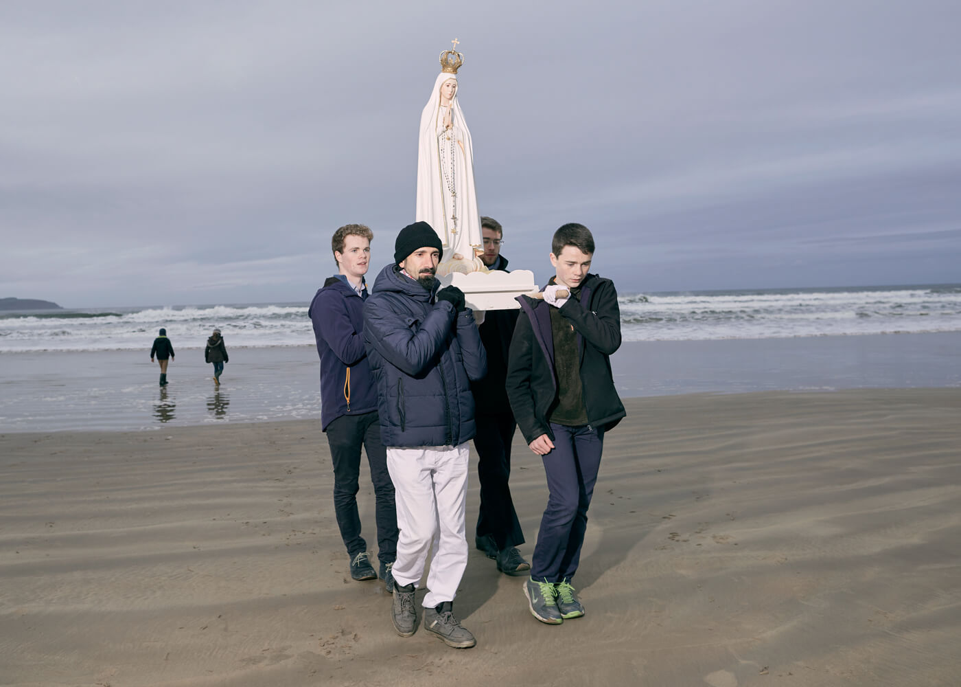 Coastal Rosary, Benone beach.  Catholic students carry a statue of Mary as part of a co-ordinated nationwide coastal rosary prayer to stop the evil of abortion coming onto Irish shores.