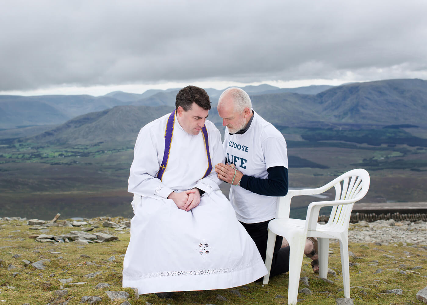 Climb of Atonement, Croagh Patrick, County Mayo.  Aidan begs forgiveness for the sins of men that may have resulted in abortion at the summit of holy mountain Croagh Patrick.