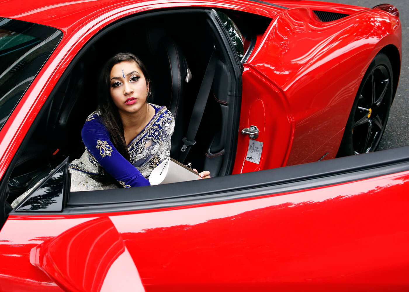 Halimah arrives for the supercar parade.
