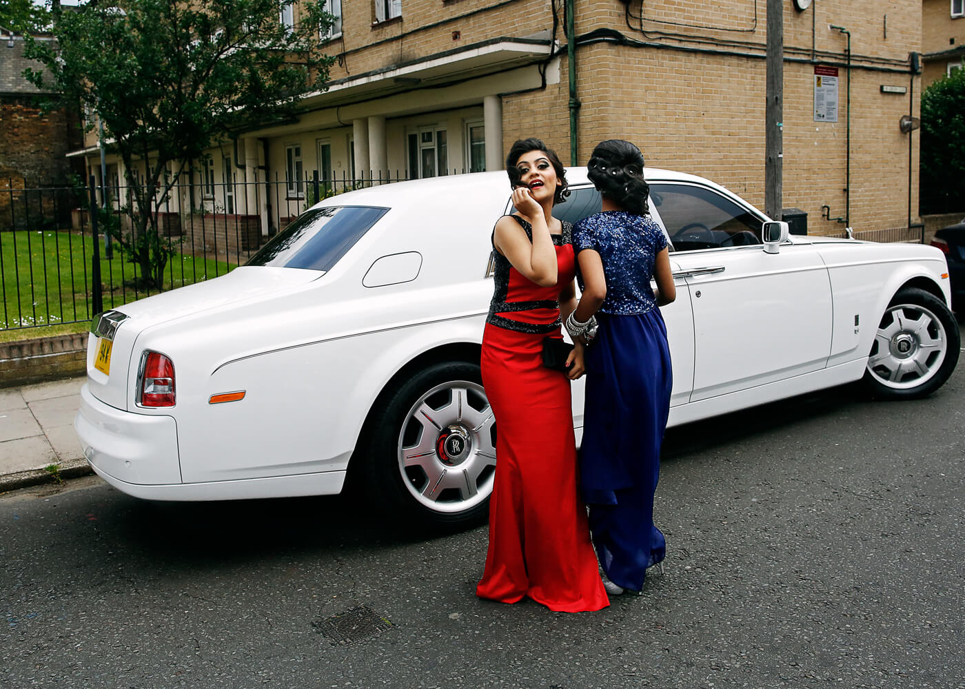 Tahmina Ahmed, 16, poses in front of a Rolls Royce.