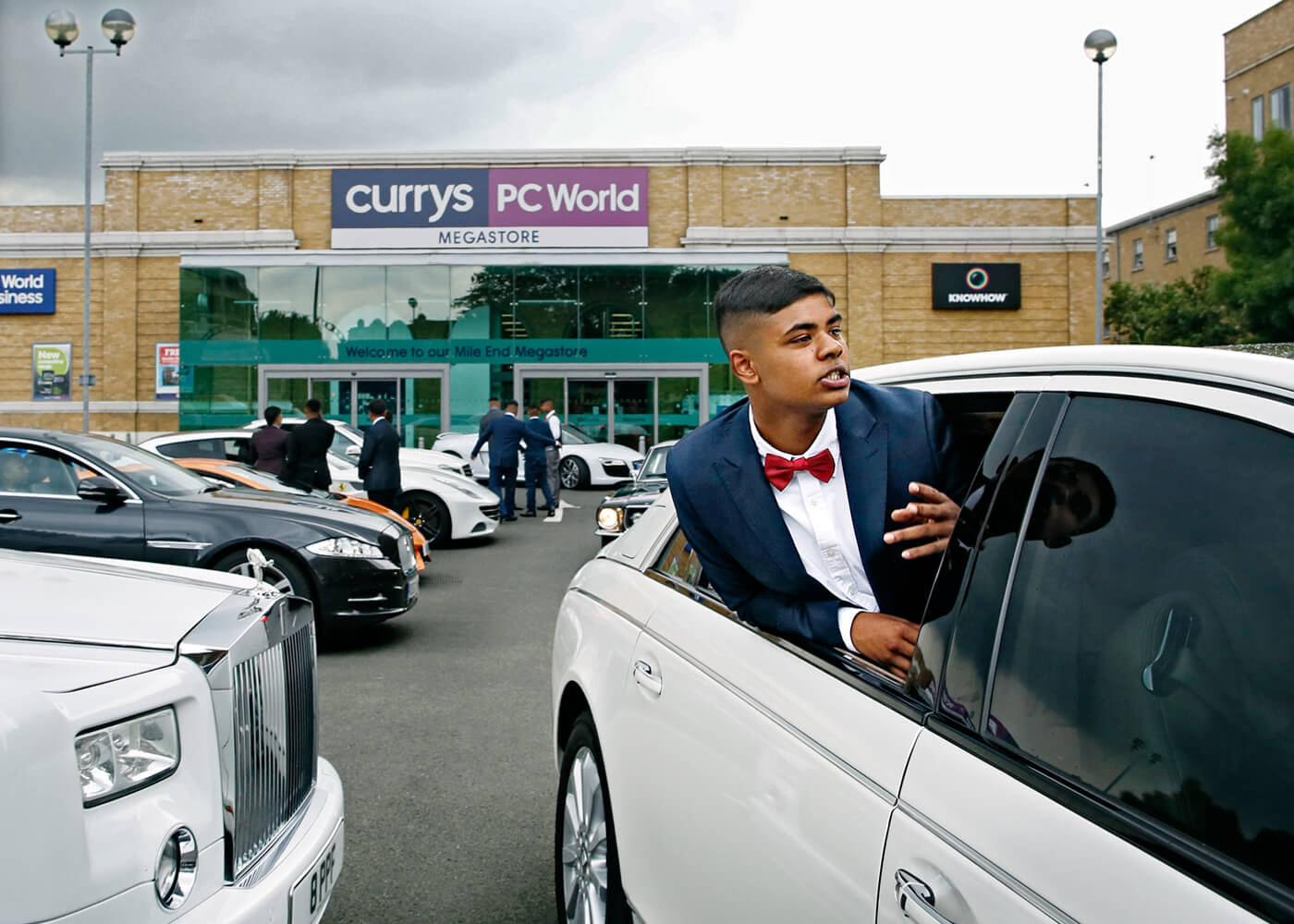 Samad Ahmed, 16, leans out of a Maybach.