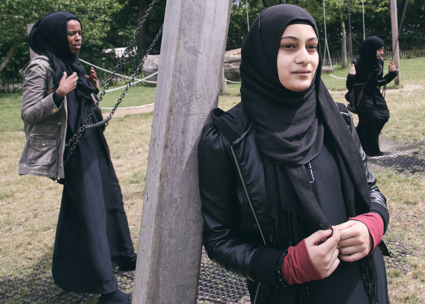 Hana, 16, celebrates in the park after finishing her last GCSE. She started wearing her headscarf full-time aged 12. She was already wearing it everyday for school so it was easy for her to make the decision.