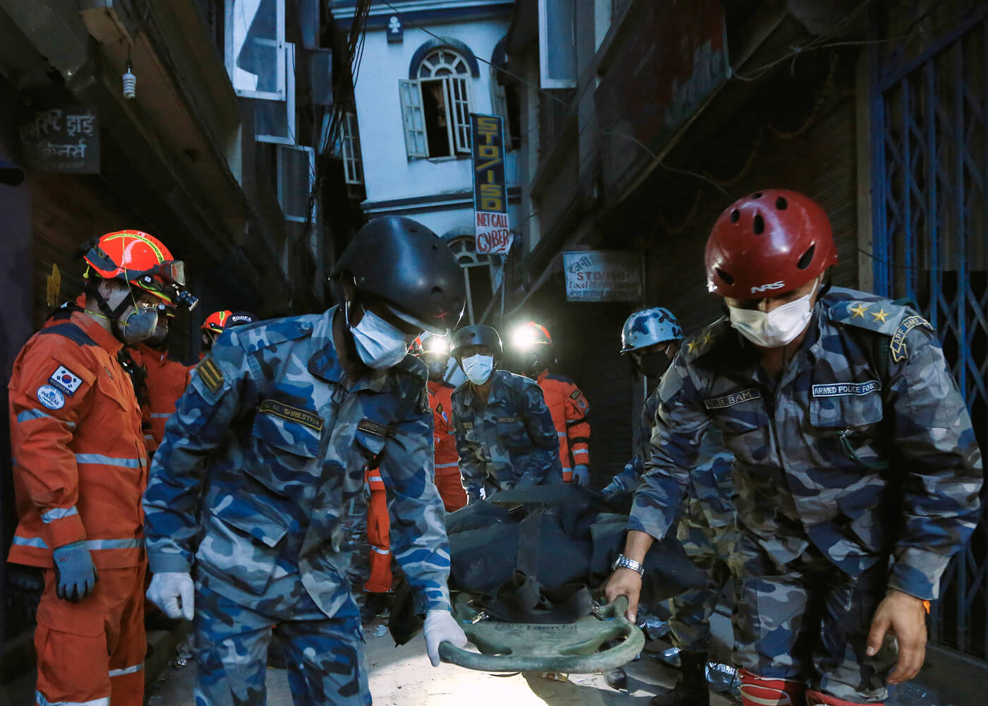 A body is recovered from a collapsed building by a South Korean emergency rescue team.