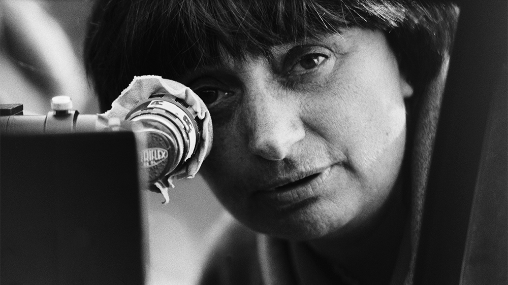 Agnès Varda behind her camera. Photography by Gamma-Rapho via Getty Images