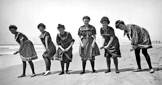 Women wearing turkish-style bloomers made of flannel at the beach in the 1900s.