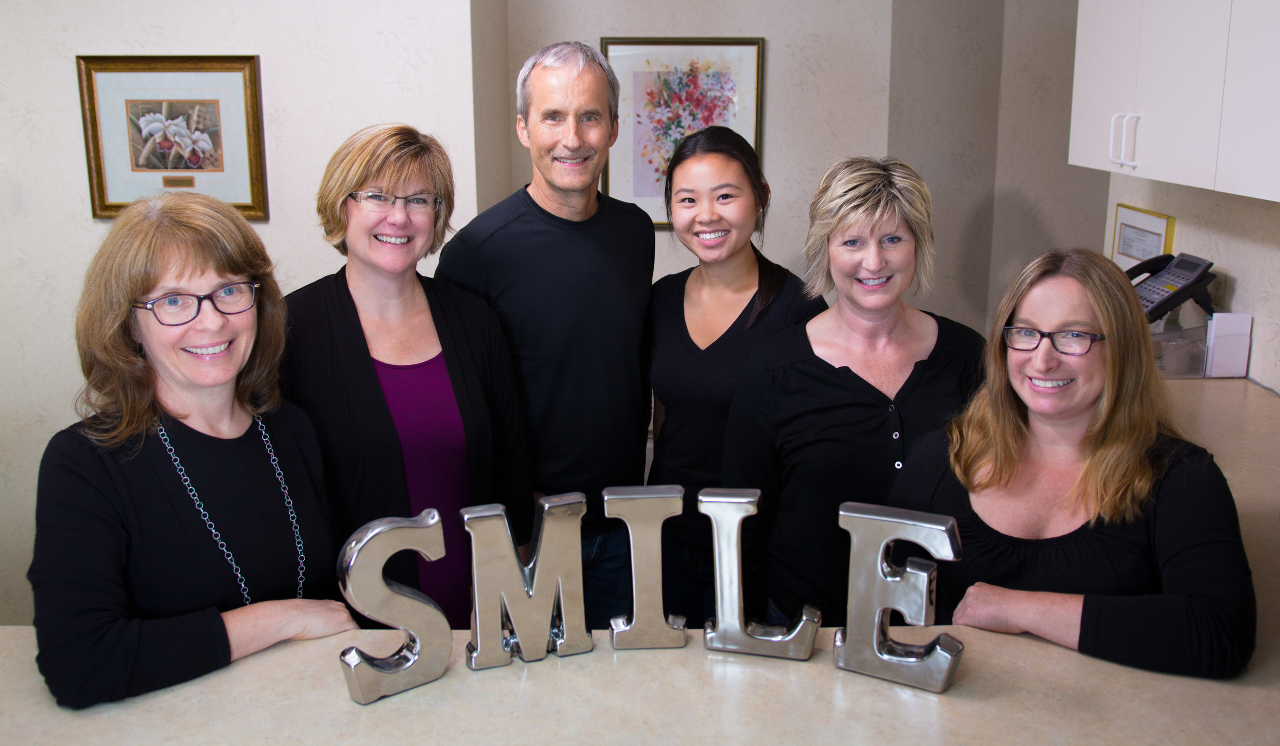 We are Dr. Wilson's team!   Becky, Office Manager / Amy, Patient Care Coordinator / Dr. Wilson / Jill, Assistant / Sheila, Treatment Coordinator / Jenny, Hygienist