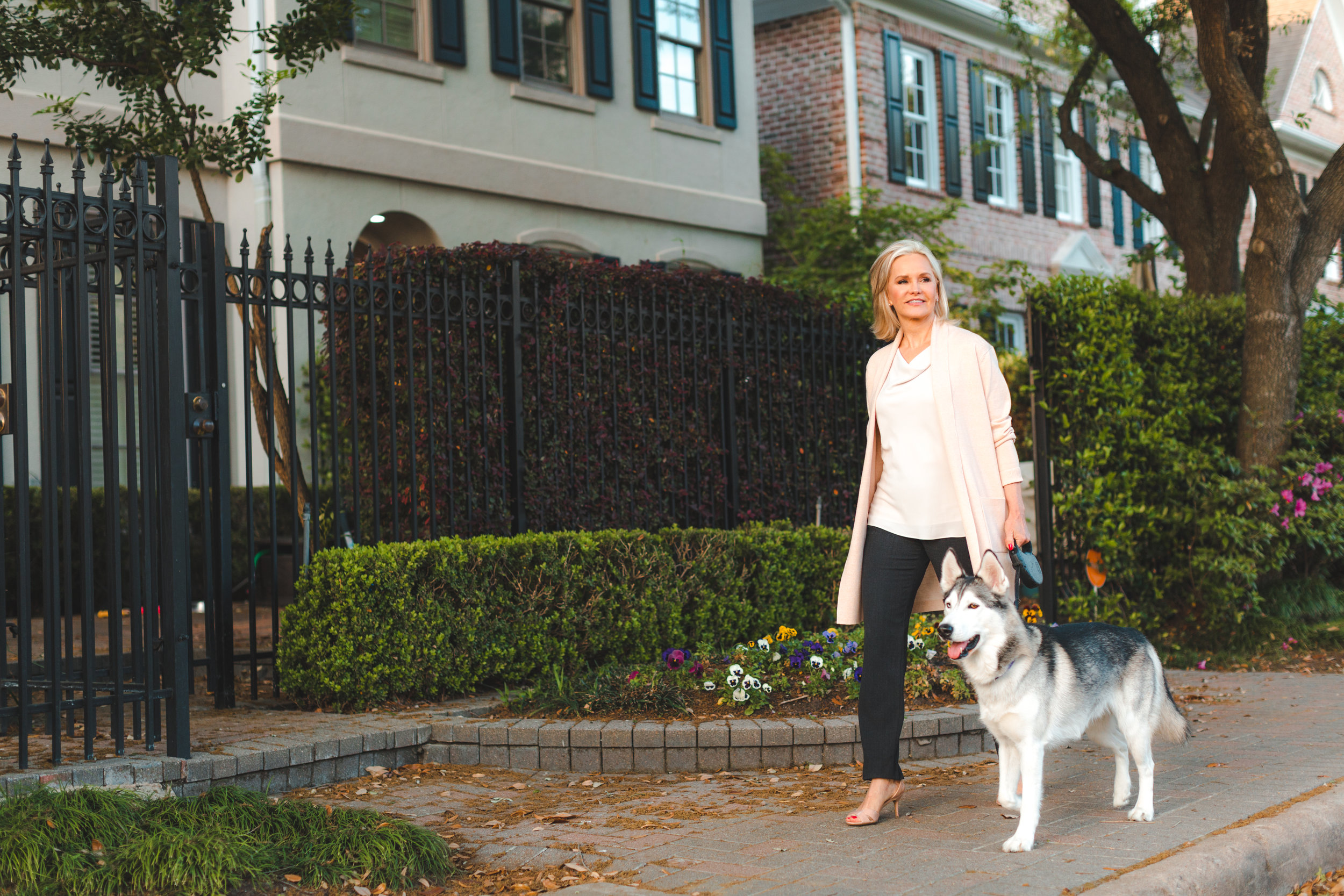 Family law attorney, and founder of Love, Money & the Law, Cindy Hide, taking her dog, star, for a walk around the block outside of her family law practice in Houston, Texas.