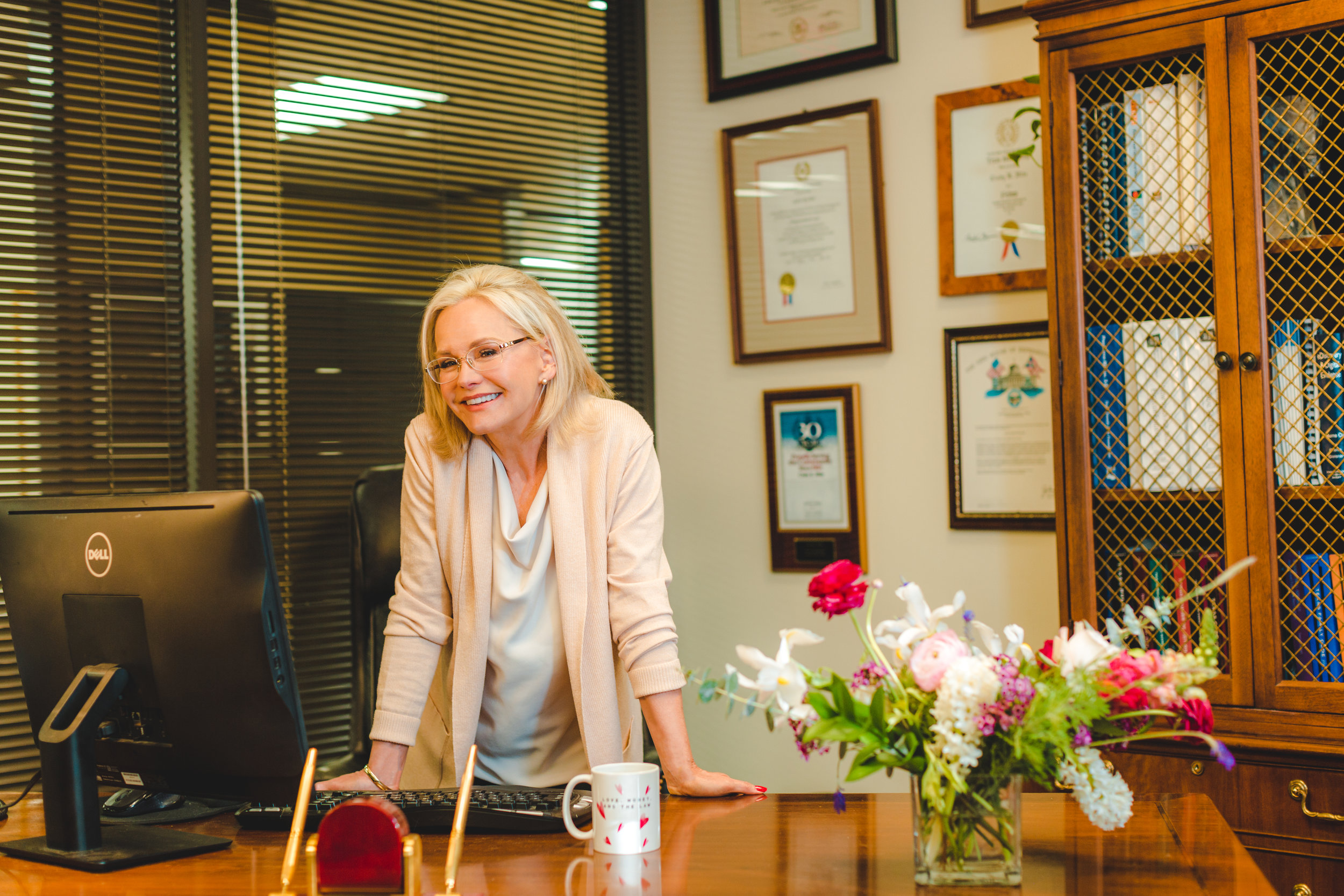 Family law attorney, and founder of Love, Money & the Law, Cindy Hide, at her desk inside her family law practice in Houston, Texas.