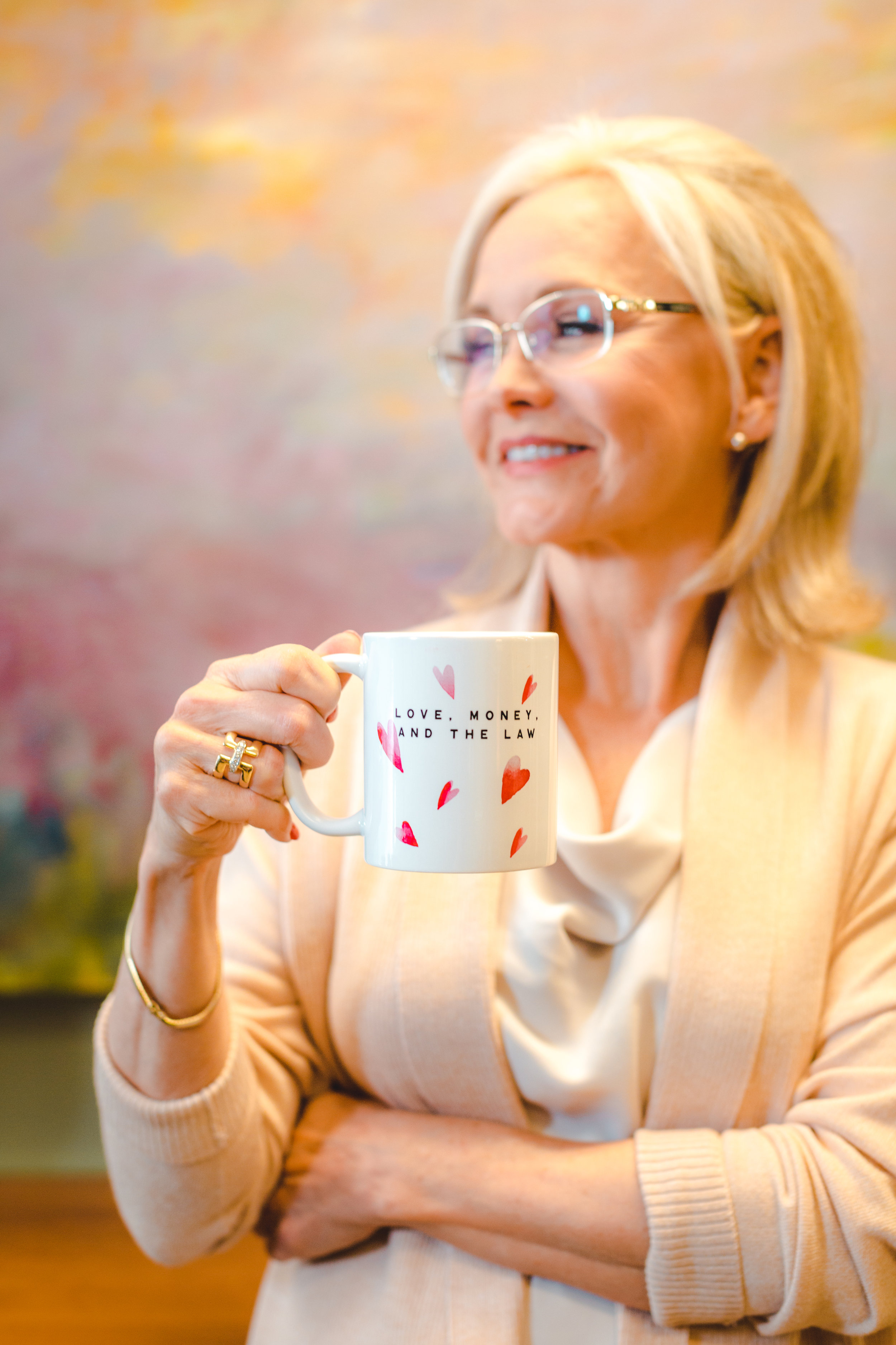 Family law attorney, and founder of Love, Money & the Law, Cindy Hide, drinking coffee inside her family law practice in Houston, Texas.