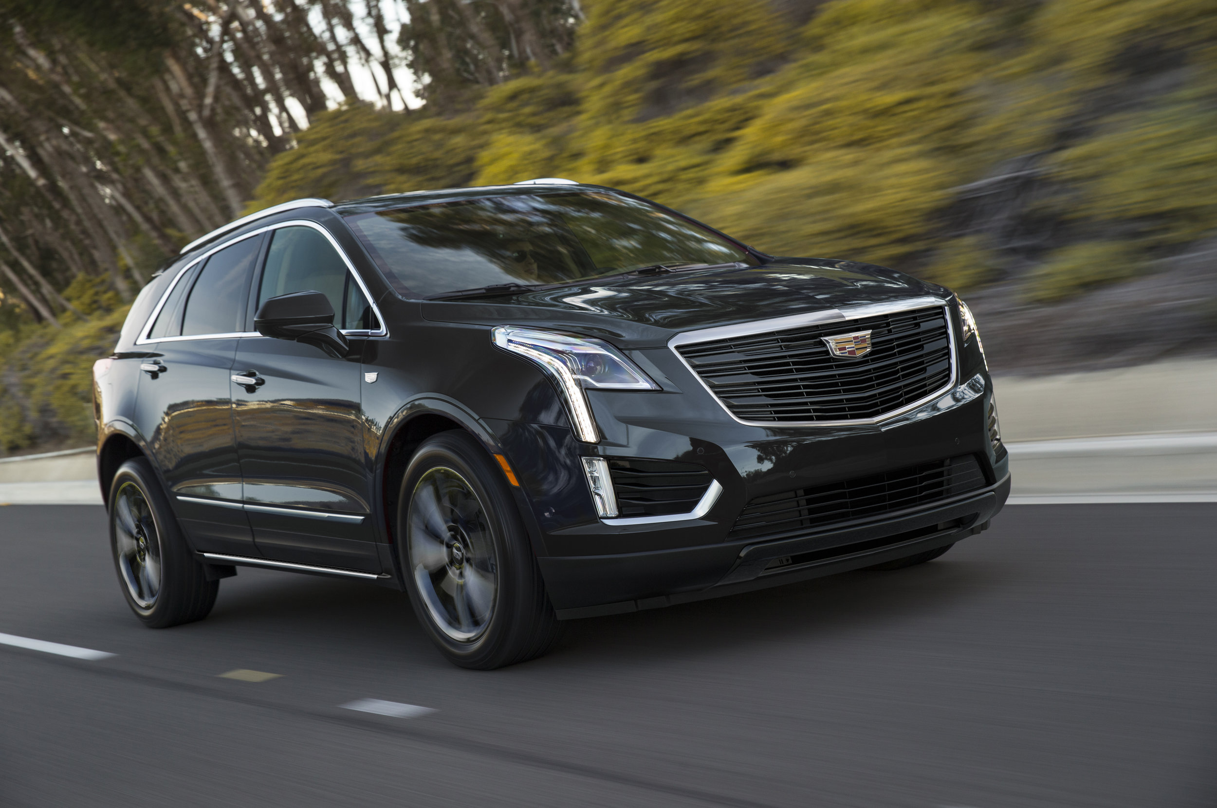 The 2019 Cadillac XT5 Sport package is infused with darkened ext