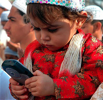 muslim-kid-holding-cell-pho.jpg
