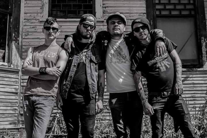 """KNOCKIN' BONES - Knockin' Bones was founded by Marc Alan (formerly of Bass Line Bums) at the end of 2014 after the Bums split up. Marc soon there after asked Dylan to join the band as they had been speaking about playing music together for years. Knockin' Bones recorded a 4 song EP in February 2015 and hit the road soon thereafter. After two years of touring and playing local shows, Knockin' Bones recorded their side of a 12 inch split with Buried Cities titled """"Tried and True"""" along with their first European tour to support the vinyl. Knockin' Bones also went on an extended hiatus in 2017 while Dylan pursued his solo career, Marc pursued his solo career and Nathan pursued his band The Butts. Knockin' Bones still get together to play a few times a year, most recently in January 2019."""