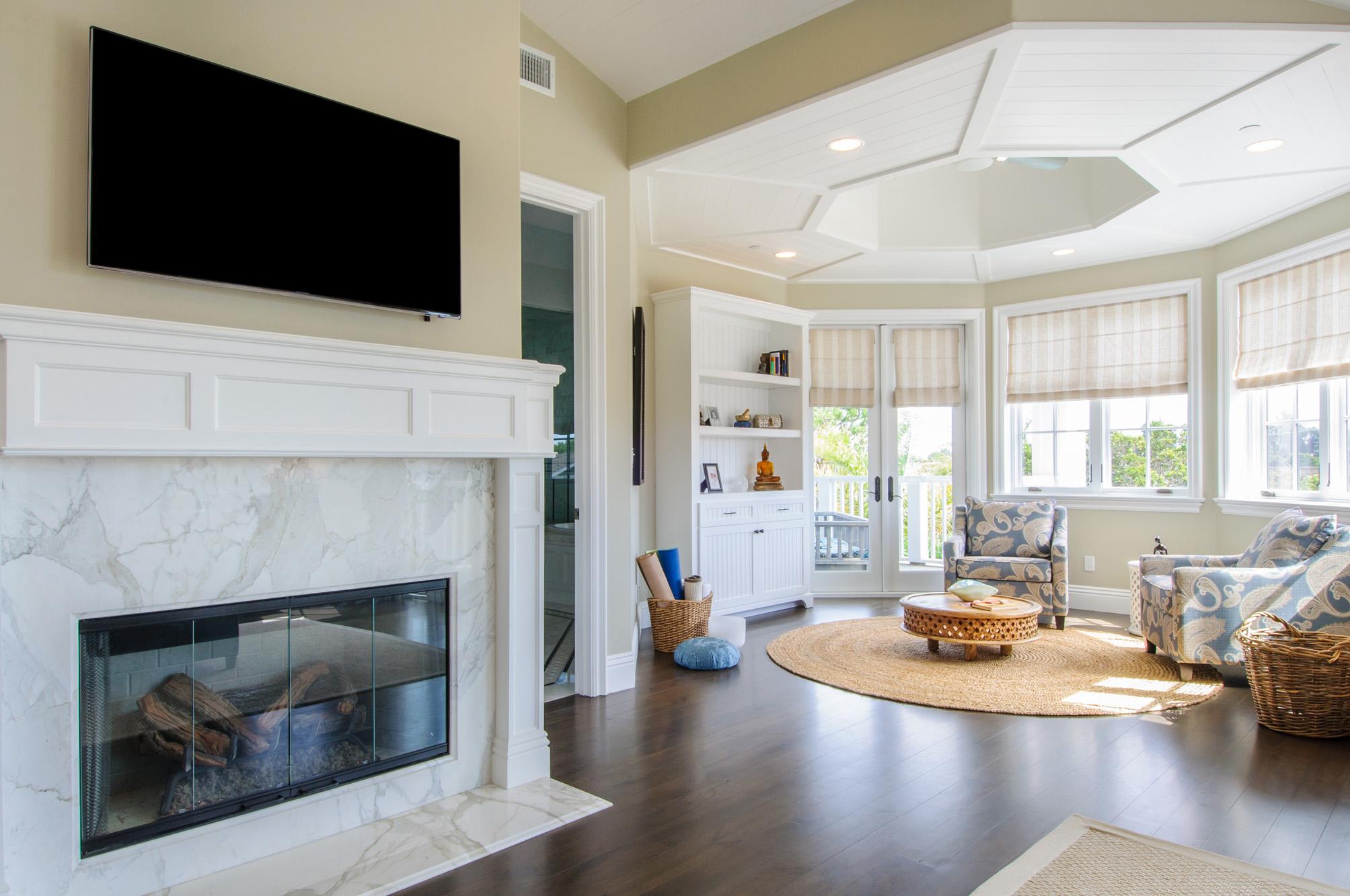 capecod - marble fireplace - walnut floors.jpg