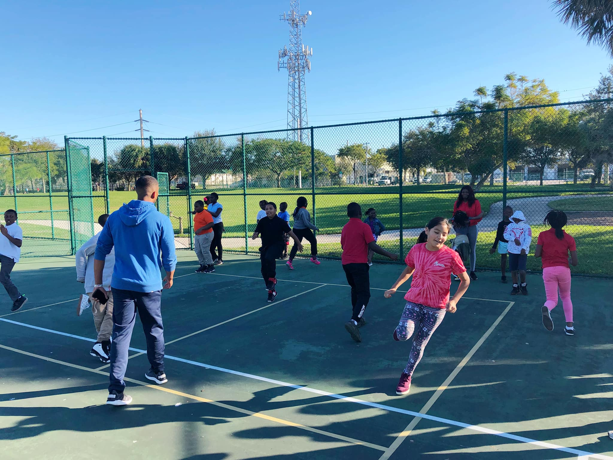 Our students warming up for their tennis lesson at Catherine Strong Park.