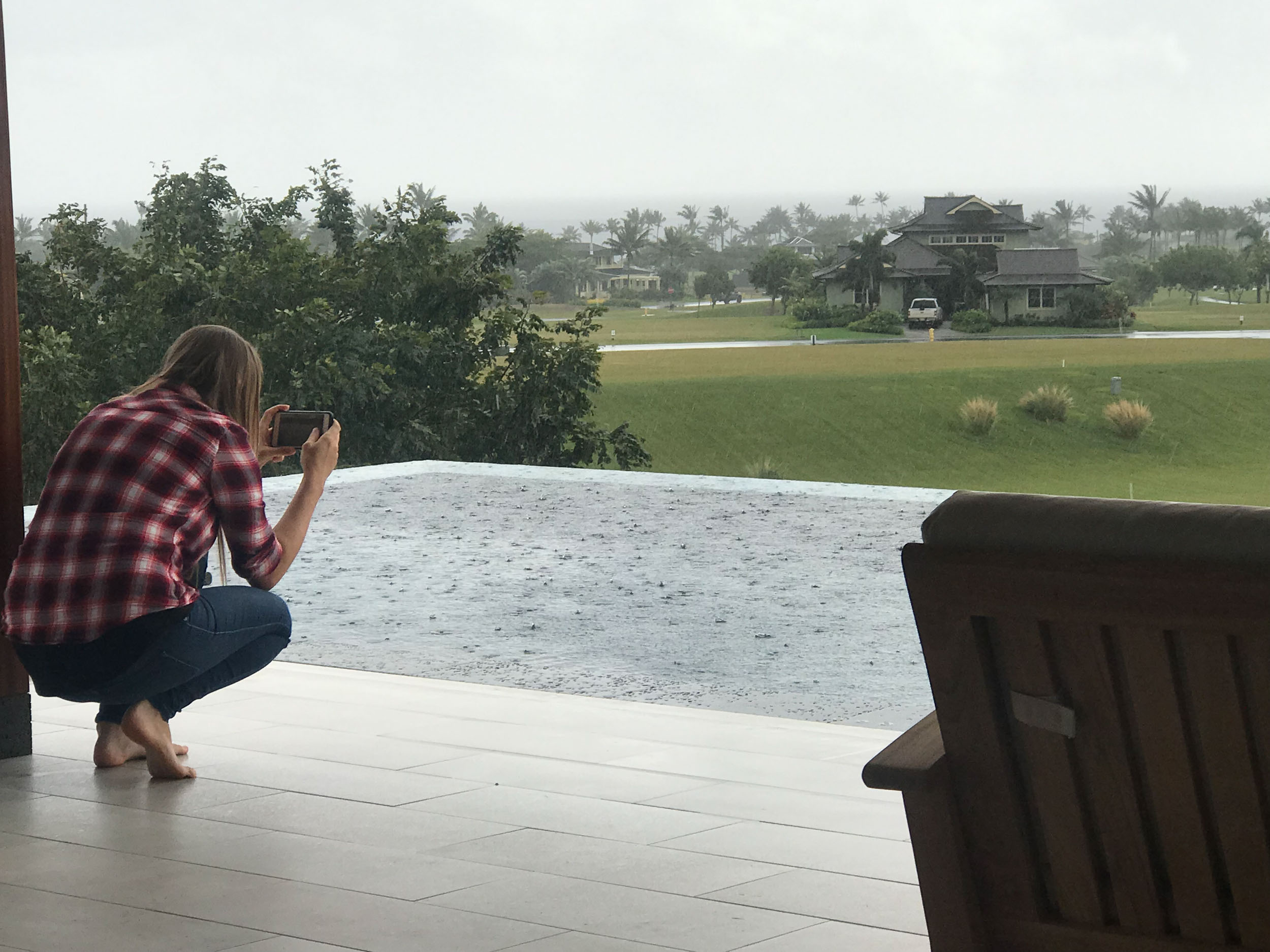 Anna my assistant taking pictures of the rain on our last half day at the house.