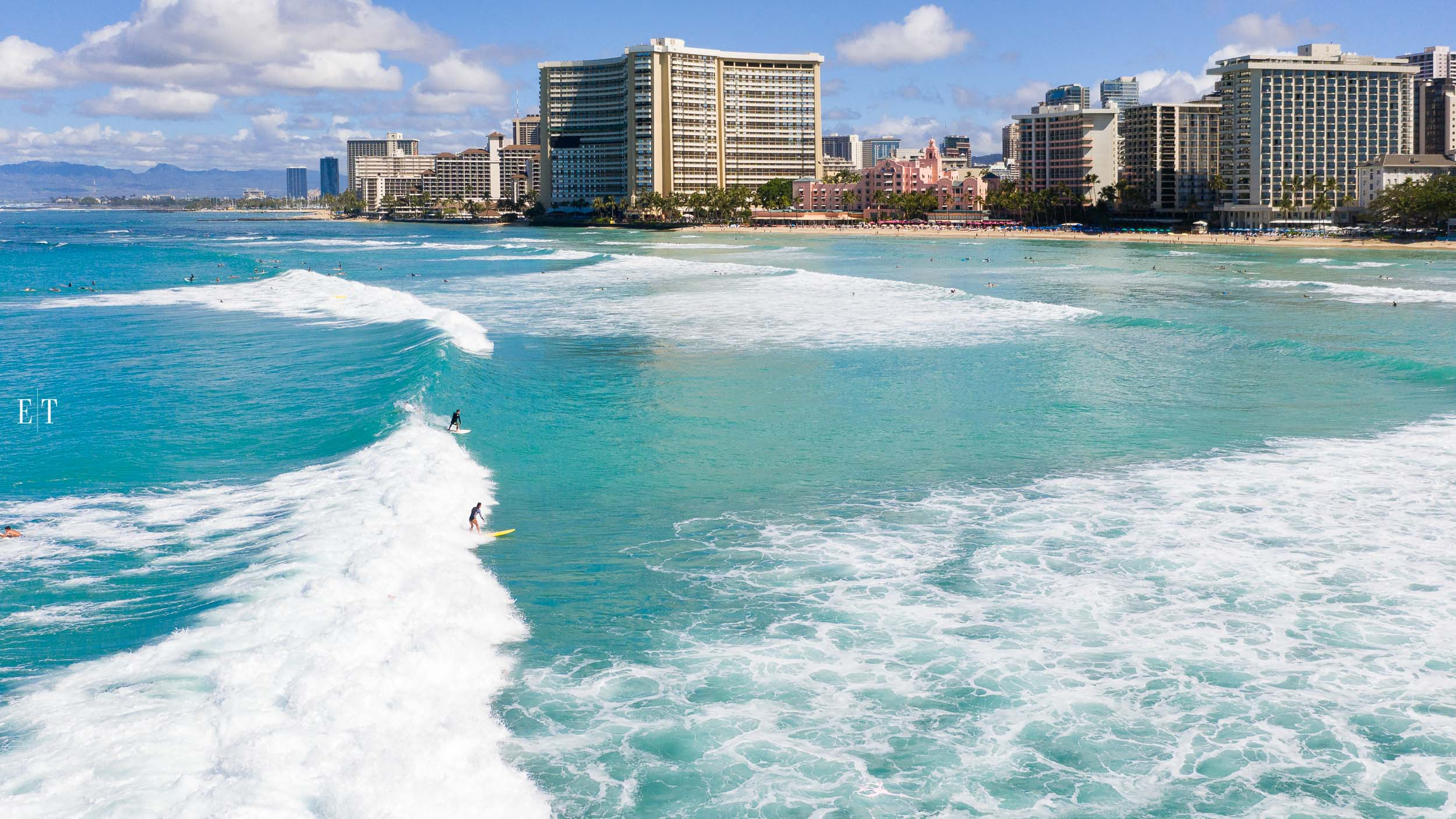 Two surfers, Waikiki Beach