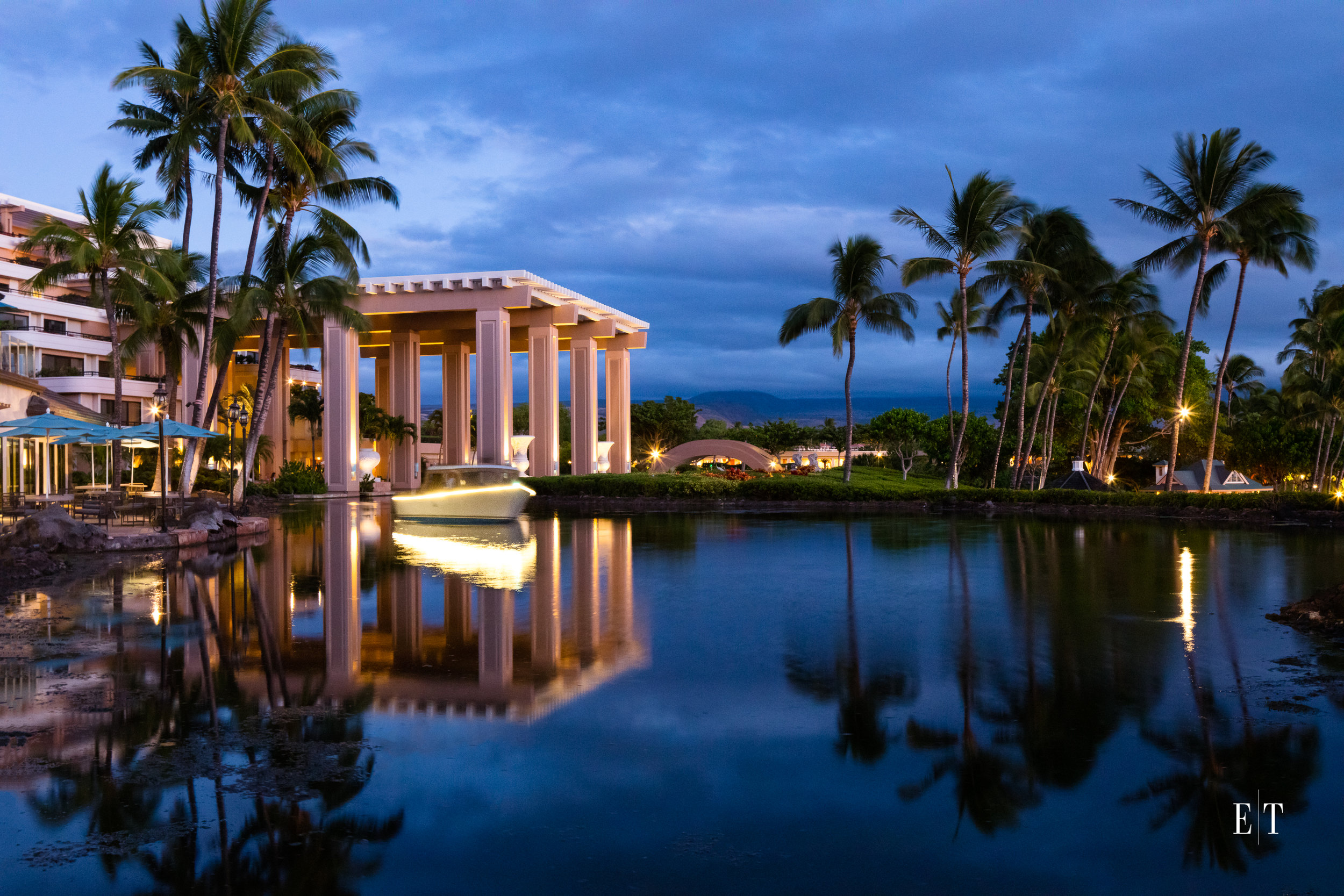 Hilton Waikoloa Village with new electric boat at twilght