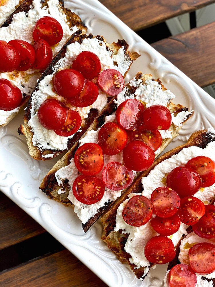 whipped ricotta crostini with cherry tomatoes