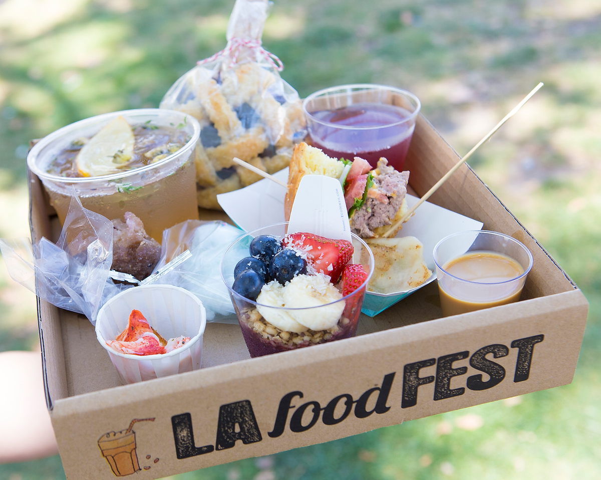 The Loot! Enjoying some tasty tastes. — LA Food Fest | LA's original tasting event | June 29, 2019 at Santa Anita Park, Arcadia, CA