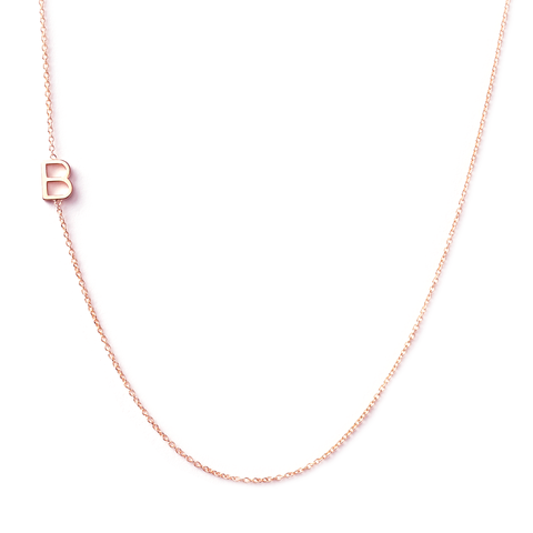 I have this  Maya Brenner  letter necklace. Greg gave it to me the day Dean was born. It has all four of my boys initials on it. I never take it off. There are many different custom options, and her jewelry is all so delicate but durable.