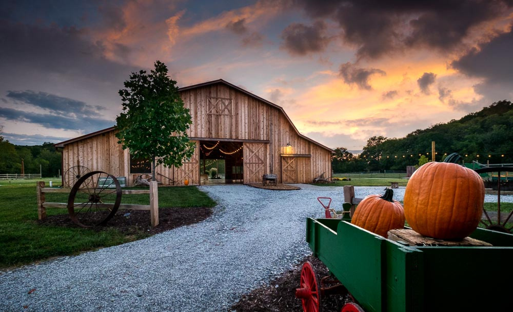 Valley Farms - No list would be complete without a farm venue, right? That's where Valley Farms takes the cake. Valley Farms in Foristell, MO (just outside of O'Fallon, MO), is a gorgeous place with ample space around several acres to explore. When you pull up to Valley Farms, you simply feel at home. When you walk in and see the functional rolling door walls and draped lighting, your jaw drops.