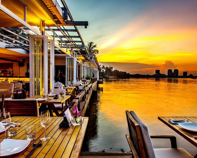 The Deck Saigon - The Deck Saigon sits on the banks of the Saigon River, a short 15 minute journey from the heart of Ho Chi Minh City. After the summit, guests will take a sunset cruise in wooden boats to the restaurant that serves the city's best Pan Asian cuisine.