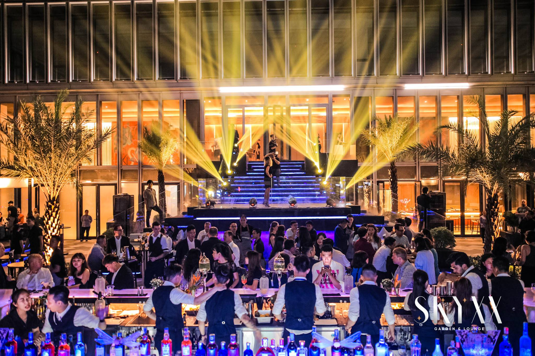 SkyXX - Perched on top of the Deutche Hause building at Le Duan Street in District 1, the open-air rooftop terrace comes with a vibrant atmosphere and a mix of lounge sofas, bar stools, lighted palm trees and a large, illuminated bar - which is booked exclusively for the VIP party.