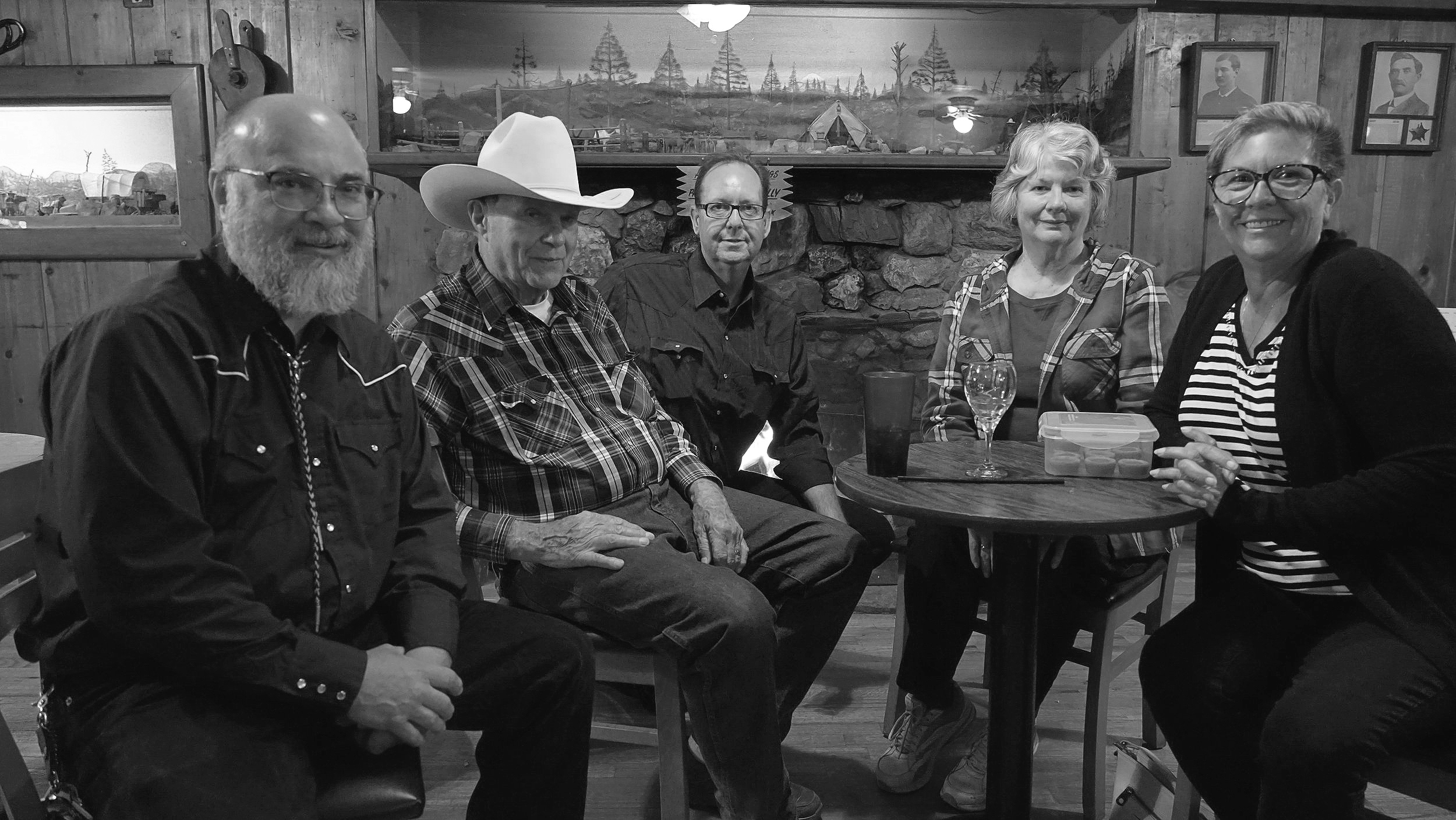 New owners James Thurin (left) Paul Frankforter (middle) and Darlyn Thurin (right) sitting with previous owners John and Rebecca Saltzgaver.