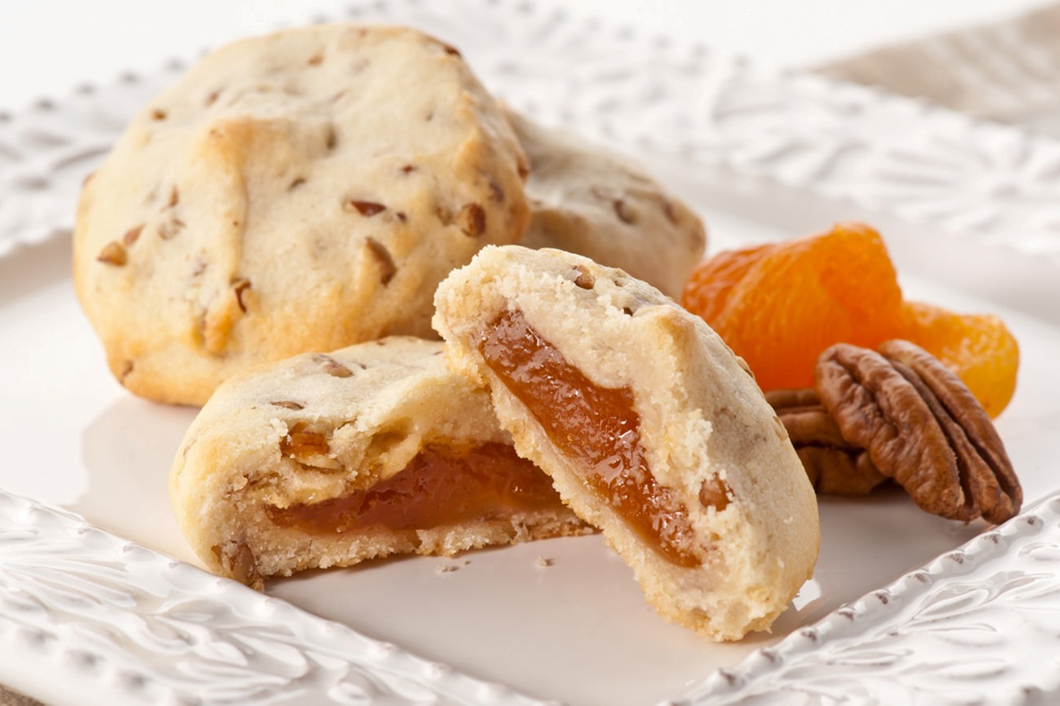 Apricot Pecan - One of our favorites, All Natural Apricot filling surrounded by the most flavorful, light pecan and cream cookie. The only way to describe it is Oh So Good!