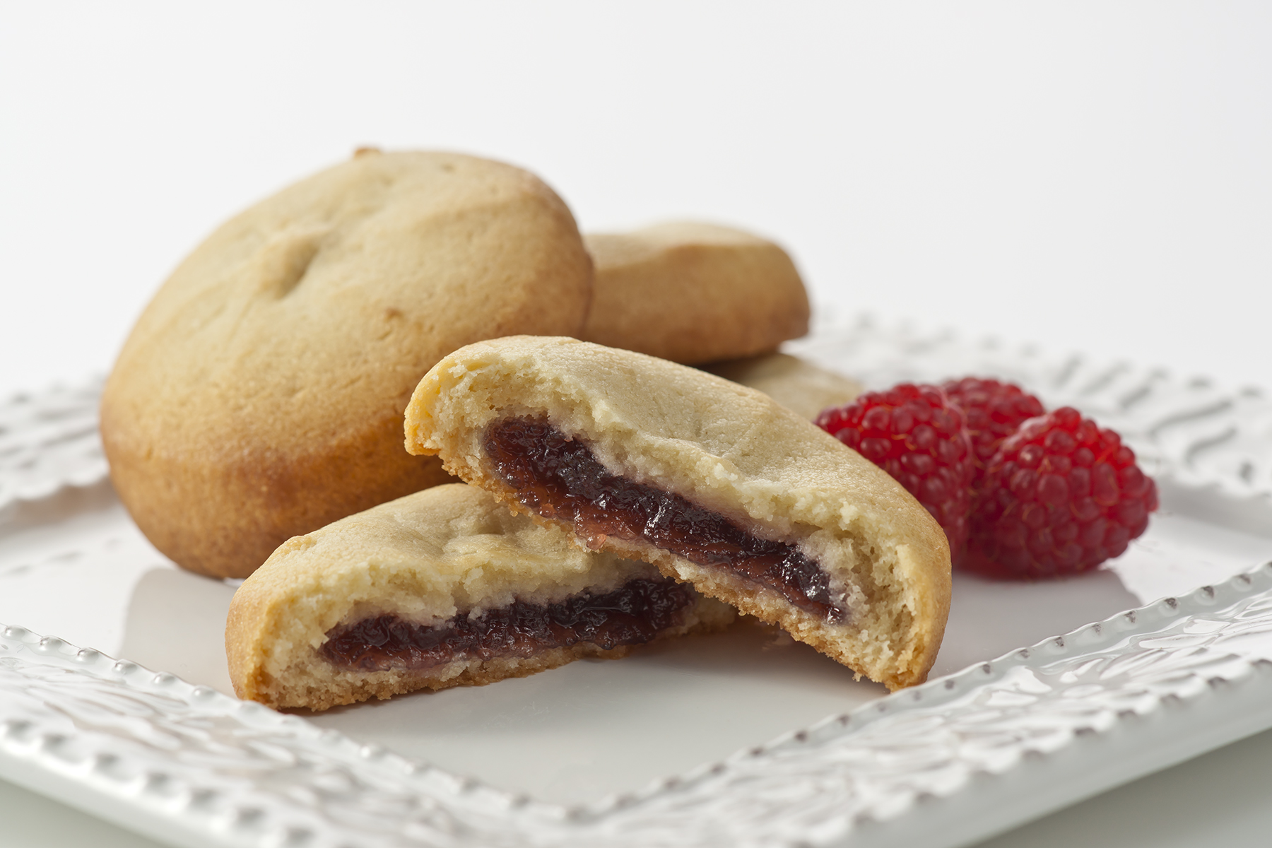 Raspberry Cream - One of our best sellers, this delicate and light cookie filled with All-Natural Raspberry filling is bursting with flavor.