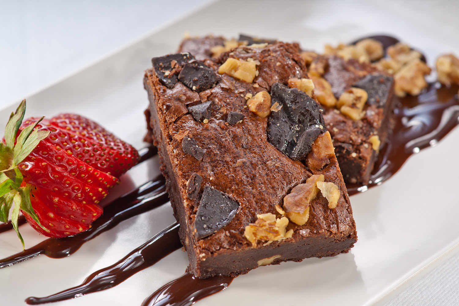 Fudge Nut Brownie - Calling all chocolate lovers: the rich, fudge flavor of this nut brownie is beyond compare! Delicious served plain or as the base for creative desserts.