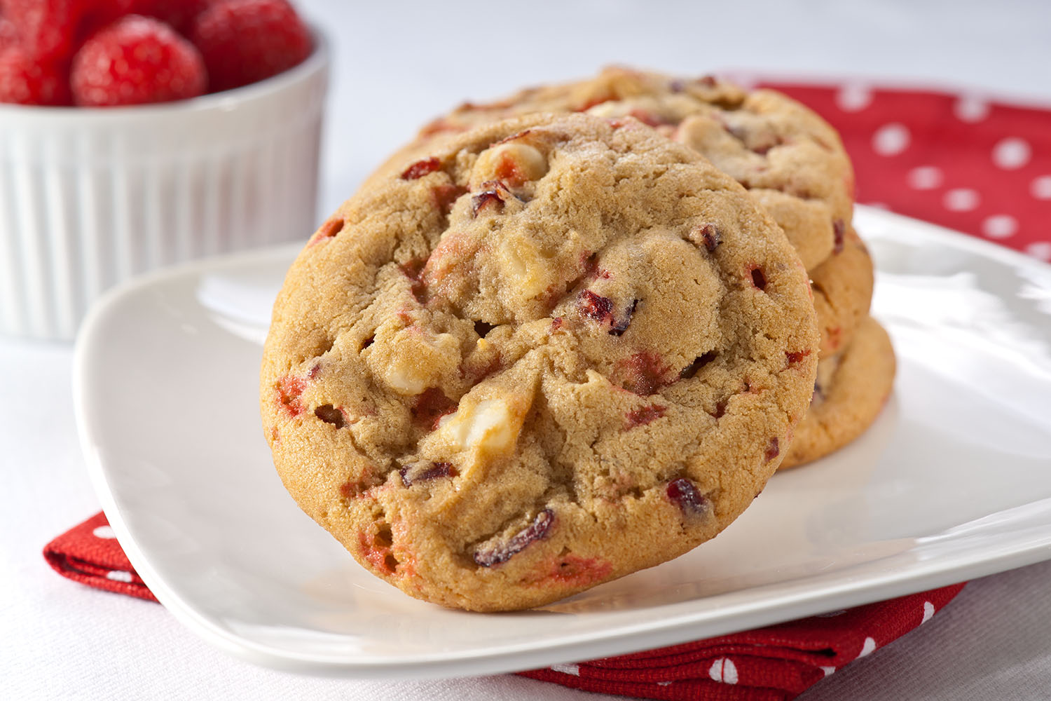 Raspberry White Chocolate - The sweetness of raspberries and the tartness of cranberries make one delicious pair, but we didn't stop there. This cookie is even better with the delicious macadamia nuts and white chocolate chips that we added for good measure.